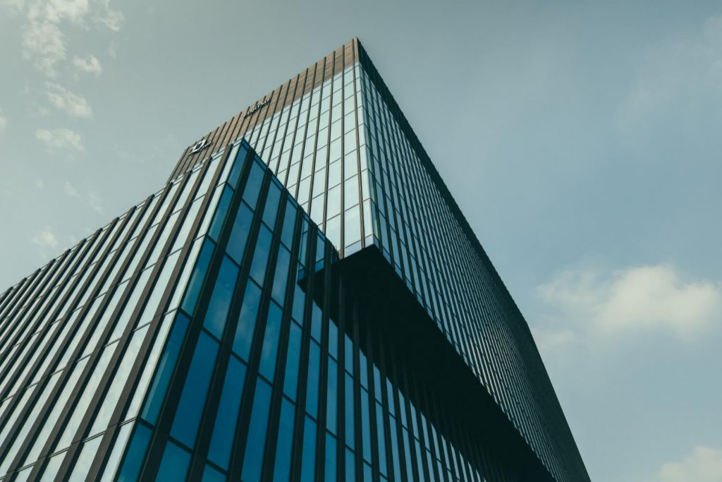 low-angle-view-building-glass-facade-beautiful-cloudy-sky (1) (1)